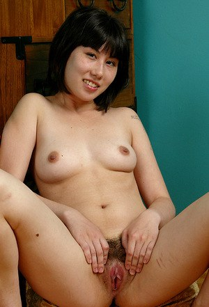 Asian first timer sheds jeans and underwear to expose hairy pussy