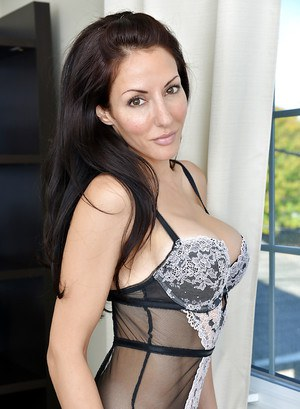 Brunette babe Olivia Bell revealing big MILF tits in nylons and lingerie