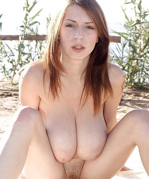 European MILF Merilyn Sakova freeing massive juggs outdoors on beach