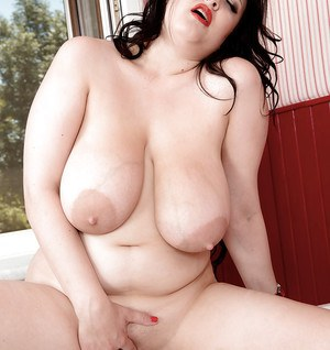Chubby brunette babe Barbara Angel freeing massive wet tits and bald pussy