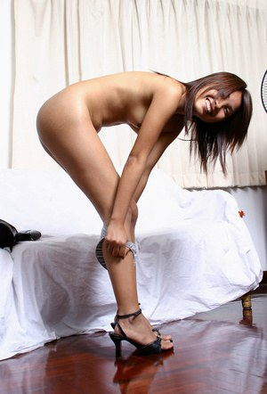 Leggy Asian first timer in high heels stripping off leather dress