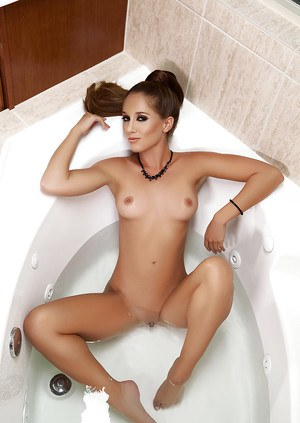 Centerfold babe Melissa Lori revealing small tits and shaved cunt in bath