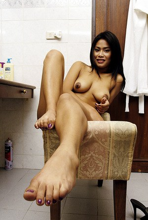 Leggy Asian first timer revealing nice tits and ass while undressing