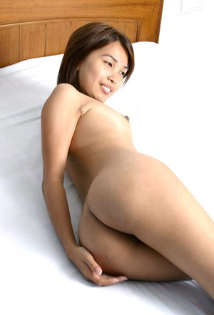 Asian first timer with small tits shedding skirt and panties to bare beaver