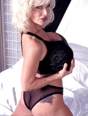 Aged platinum blonde Busty Dusty unleashing monster tits and tattooed ass