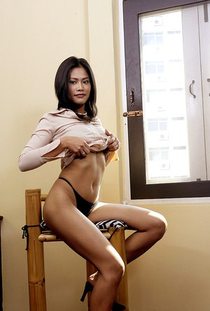 Amateur Asian babe shedding lingerie and skirt while undressing