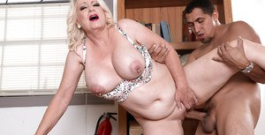 Granny Angelique DuBois revealing large natural tits and pierced nipples