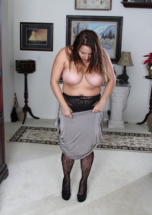 Pantyhose clad Italian BBW CeCe Giovanni revealing huge MILF boobs
