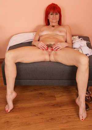 Leggy mature redhead Amanda Rose revealing hairy cooter while undressing