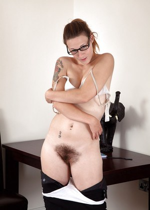 Glasses wearing office worker revealing tattoos and hairy cunt