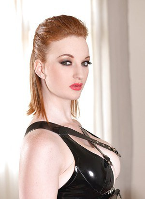 Busty redhead Zara DuRose modeling for babe photos in latex outfit