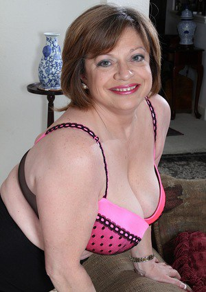 Older fatty Kathy Gilbert strutting in nylons while exposing large breasts