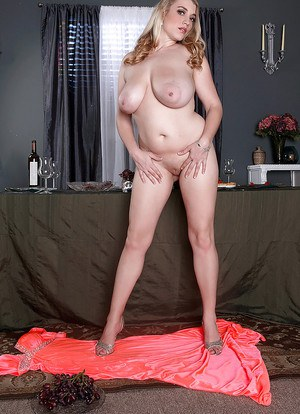 Chubby blonde Melissa Manning unveiling massive juggs and ass in high heels