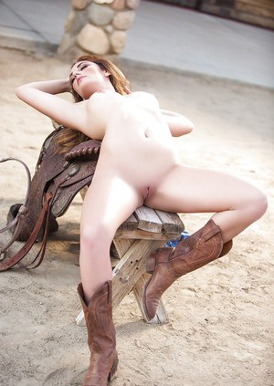 Centerfold model Lauren Love baring nice tits and ass outdoors in boots