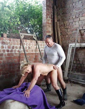 Mature European pornstar in boots giving hardcore oral sex outdoors