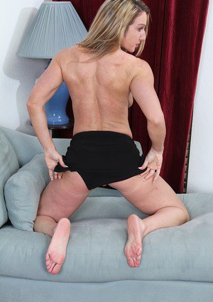 Leggy aged woman Ashley Brooke slipping off skirt and panties in high heels