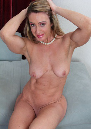 Older lady Ashley Brooke undressing for baring of saggy tits and bald cunt