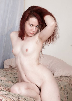 Small boobed redhead babe Annabelle Lee baring hairy cunt for masturbation