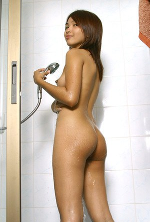 Tattooed Asian first timer shaving sexy legs in bathroom before showering