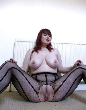 Amateur European BBW Donna Austin freeing huge boobs from bodystocking
