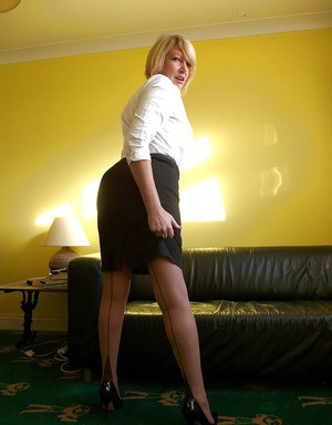 Stocking and skirt attired older blonde unveiling big tits and bald cunt