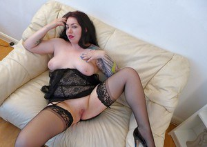Tattooed Euro plumper Nikki Gold freeing big first timer tits from lingerie