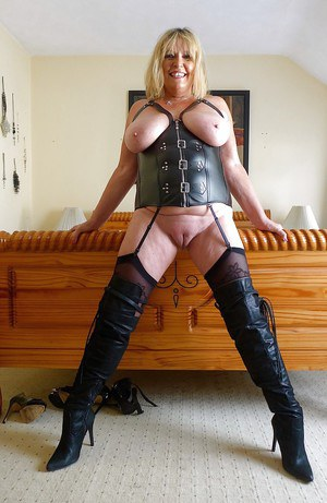 Stocking and stripper boots attired amateur fatty displaying massive boobs