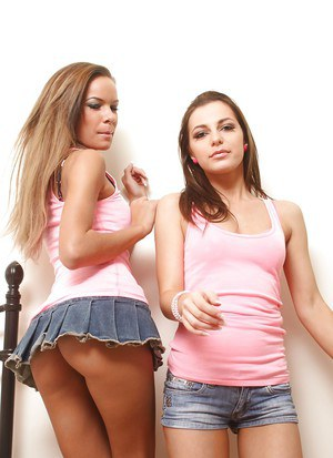 European lesbians Isabella Roe and Kyra Mendez stripping down to lingerie