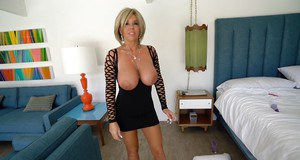 Mature blonde housewife Sandra Otterson unveiling massive juggs