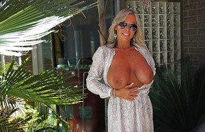 Mature housewife Sandra Otterson fondling huge knockers during babe spread