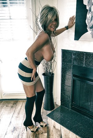 Aged housewife Sandra Otterson posing in over the knee socks for babe pics