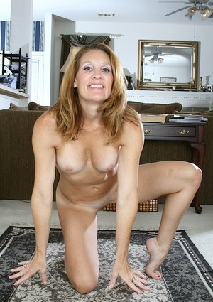 Leggy mature woman in high heels revealing big tits and trimmed pussy