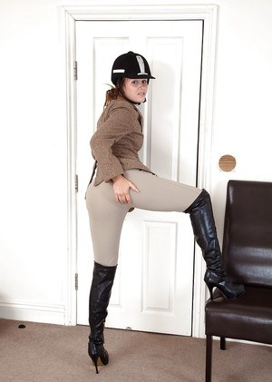 Clothed aged woman in riding boots and outfit baring hairy armpits and bush