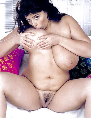 Obese Latina pornstar Kerry Marie freeing huge knockers and big butt