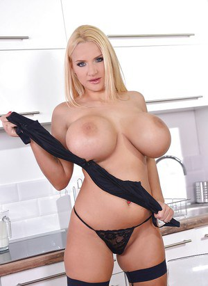 Blonde European babe Dolly Fox baring huge knockers in kitchen