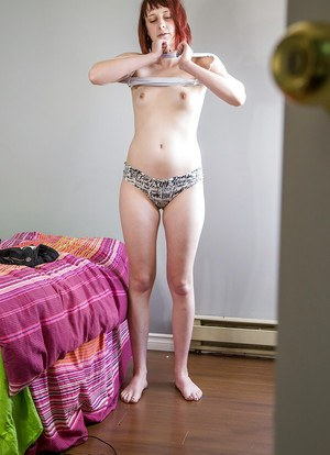 Amateur redhead babe pulling panties and shorts over bare ass