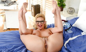Glasses and stocking clad blonde MILF Phoenix Marie displaying nice ass