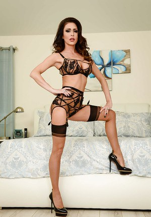 Leggy babe Jessica Jaymes freeing big tits from lingerie for babe spread