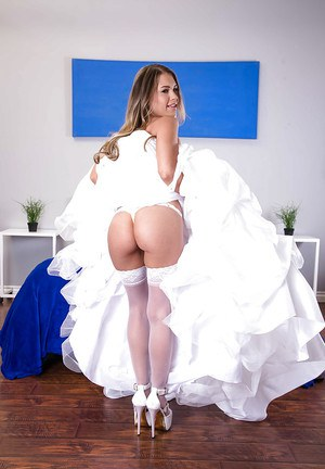 Stocking clad wife stripping off wedding dress for babe photo spread