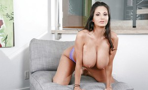 Busty wife Ava Addams flaunting big booty during babe photo spread