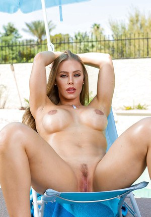 Leggy blonde babe Nicole Aniston freeing big tits from bikini outdoors