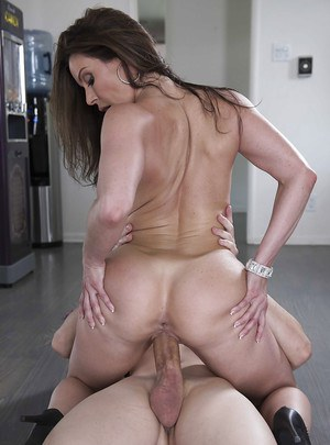 Busty wife Kendra Lust freeing big MILF tits from dress before giving BJ