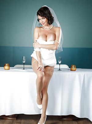 Brunette babe Veronica Avluv freeing big MILF tits from wedding dress