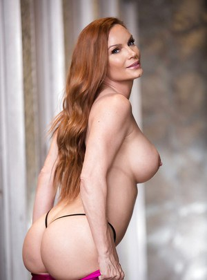 Redhead housewife Diamond Foxxx baring big tits in yoga pants for babe pics