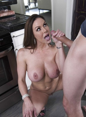 Busty brunette wife Kendra Lust giving big cock blowjob in kitchen