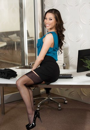 Stocking clad Asian babe Kalina Ryu freeing phat ass from skirt in office