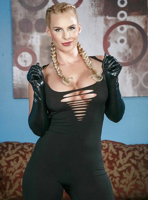 Pigtail attired babe Phoenix Marie baring big MILF tits in leather gloves