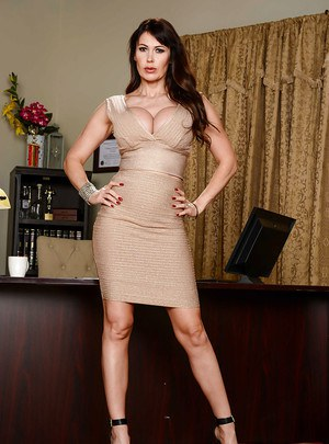 Euro babe Eva Karera shows off great legs and MILF pornstar tits in office