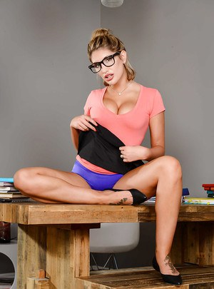 Glasses attired coed babe August Ames exposing big teen pornstar tits