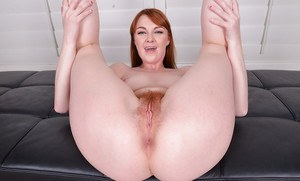Redhead babe Marie McCray sliding silk panties aside to spread hairy pussy